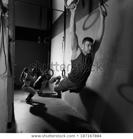 gym girls muscle ups rings swinging workout stock photo © lunamarina