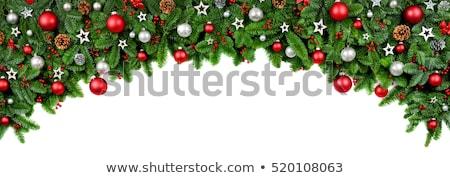 Lush fir twigs and green baubles on white Stock photo © Smileus