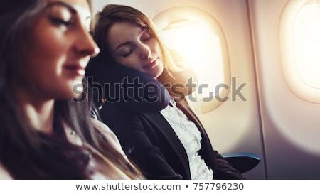 Young woman sleeping on airplane Stock photo © kasto