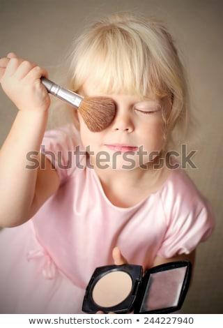 little model applying make up stock photo © barabasa