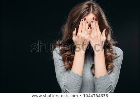 Young woman closed her ears Stock photo © deandrobot