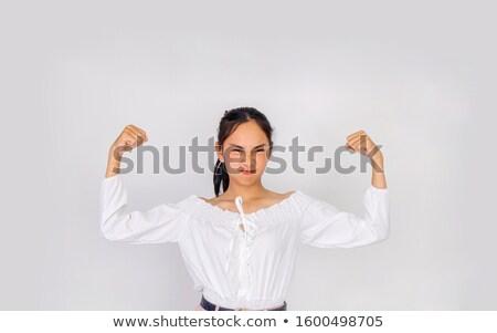sportos · nő · mutat · bicepsz · kép · fiatal - stock fotó © deandrobot