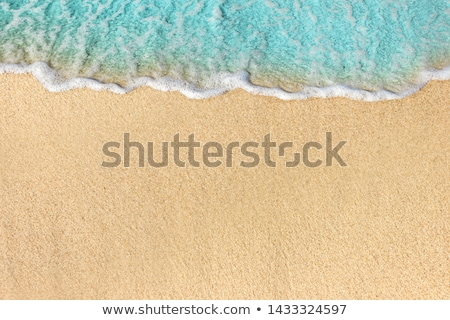 Ocean background  - Soft wave of the water on the sandy beach  Stock photo © Taiga