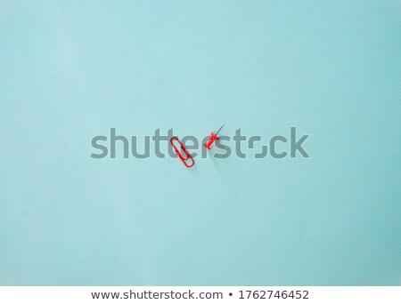 Composite image of close-up of red thumbtack Stock photo © wavebreak_media