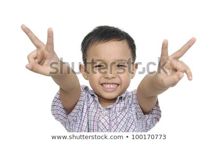 Serious boy with two fingers up Stock photo © ozgur