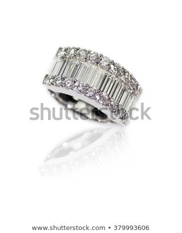 Zdjęcia stock: Diamond Encrusted Engagment Wedding Anniversary Ring With Emerald Cut Diamonds