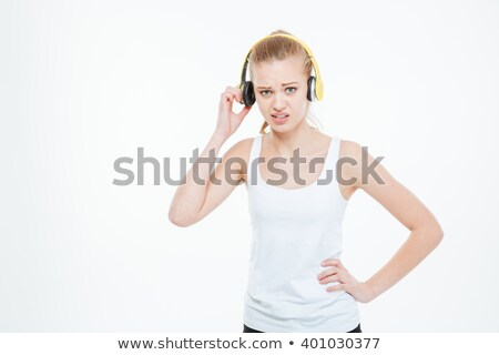 Unhappy stressed young woman removing yellow headphones  Stock photo © deandrobot