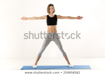 Lány testmozgás karok sportos épít nők Stock fotó © MilanMarkovic78
