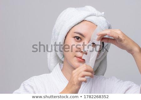 Fiatal nő jelentkezik kozmetika fiatal gyönyörű nő kéz Stock fotó © user_9834712