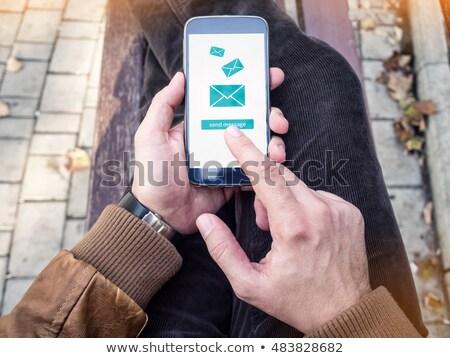 Stock fotó: üzletember · küldés · email · üzenet · modern · okostelefon