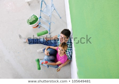 couple looking at white wall after painting stock photo © nyul