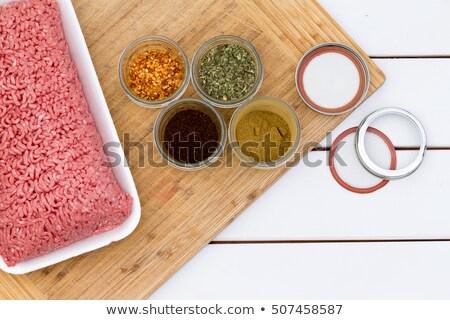 freshly minced raw beef with jars of seasoning stock photo © ozgur
