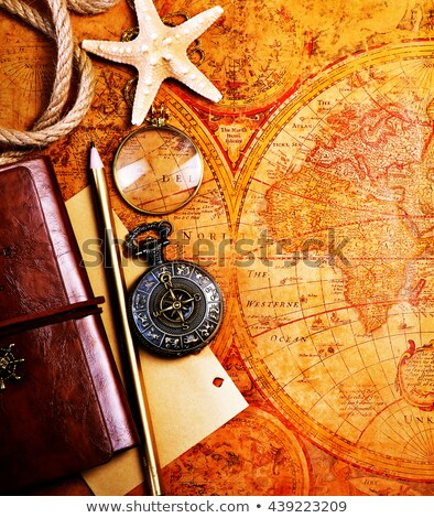 old notebook, loupe and compass on the map Stock photo © tycoon