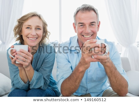 Middle aged man drinking hot beverage Stock photo © ozgur