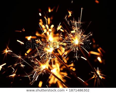 sparkler burning over black background Stock photo © dolgachov