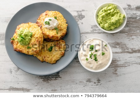 Baked cauliflower blue plate stock photo © TasiPas