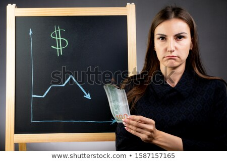 falling dollar note and graph of stock market with stock board Stock photo © Suriyaphoto