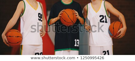 Basketball Training with Three Players and Coach. Stock photo © robuart