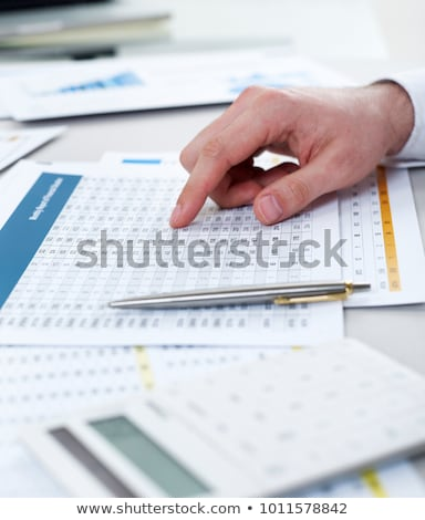 Calculator pen and financial report Stock photo © your_lucky_photo