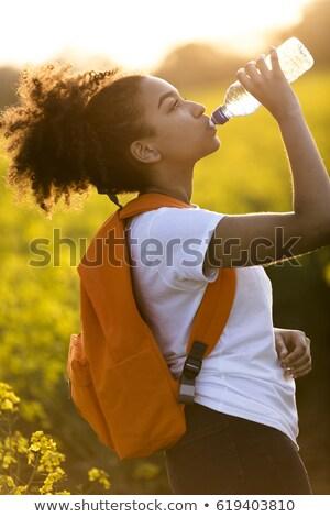 十代の少女 · 飲料 · ボトルウォーター · 少女 · 子供 · 子 - ストックフォト © dtiberio