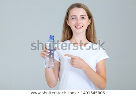 portret · uśmiechnięty · młoda · kobieta · ciepłej · wody · butelki · szczęśliwy - zdjęcia stock © nobilior