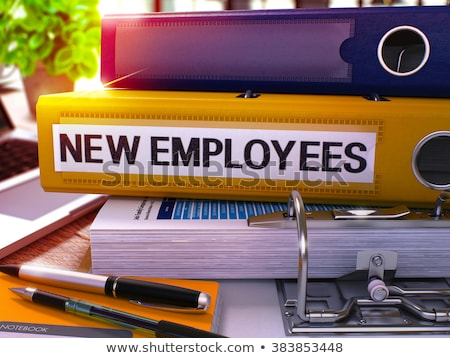 Stock photo: Yellow Office Folder with Inscription New Employees.
