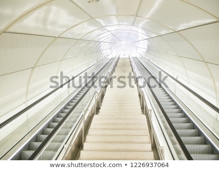 Tunnel in airport with mechanical passage stock photo © Photooiasson