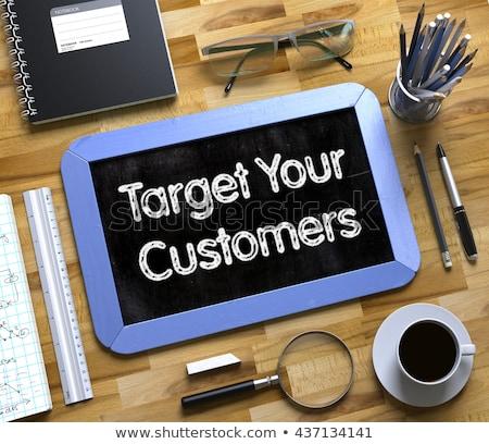 target your customers   text on small chalkboard stock photo © tashatuvango