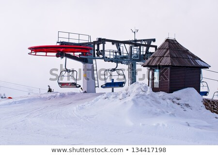 Ski lift mechanism wheels and cable Stock photo © Mps197