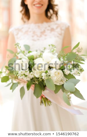 Stockfoto: Young Pretty Bride With Bridal Bouquet Indoors