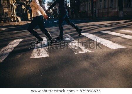 Couple holding hands crossing street Stock photo © IS2