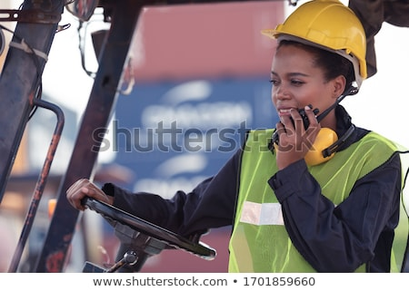 Worker using machinery in shipping yard Stock photo © IS2