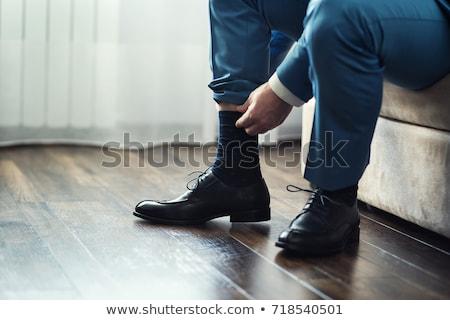 Man sokken slaapkamer mannelijke recreatie ochtend Stockfoto © IS2