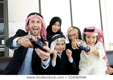 Garçon jouer jeu vidéo famille heureux Photo stock © monkey_business