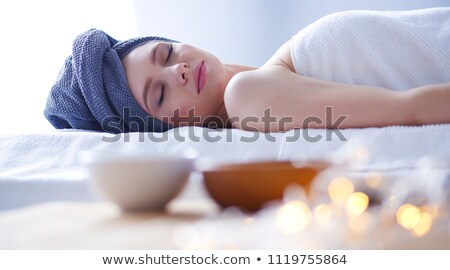 lying down woman with rose Stock photo © phbcz
