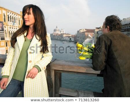 Couple with flowers on Academia Bridge Stock photo © IS2