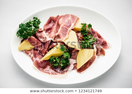 jamon serrano parma prosciutto style smoked ham with mango fruit Stock photo © travelphotography