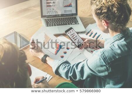 Fiatal lány asztal iroda táblázatok diagramok iratok Stock fotó © Traimak