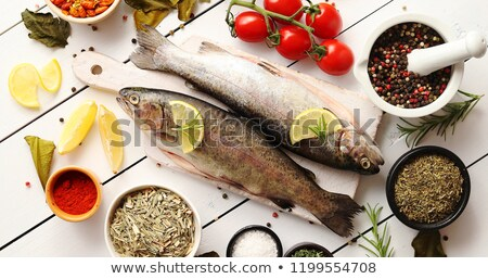 aromatic spices and vegetables around fish stock photo © dash