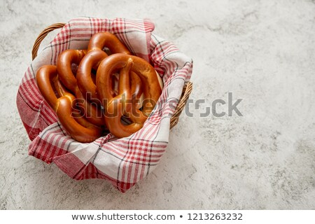 Basket with red and white checkered napkin filled with fresh brown pretzels Stock photo © dash