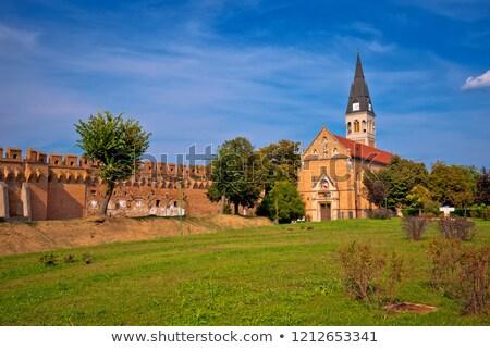 Town of Ilok defense walls and church view Stock photo © xbrchx