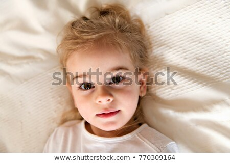 young daughter two years old relaxing in bed, positive feelings Stock photo © Lopolo