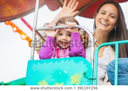 Foto d'archivio: People Park Mother Daughter Entertain Girl Riding