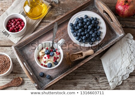 Cottage cheese with ground flax seeds and blueberries Stock photo © madeleine_steinbach