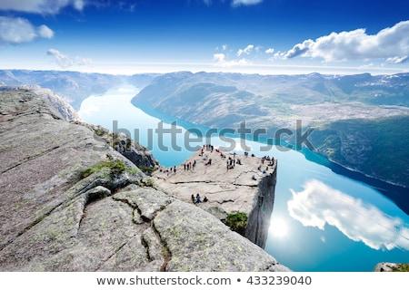 Uçurum Norveç şaşırtıcı kaya kız ayakta Stok fotoğraf © Kotenko
