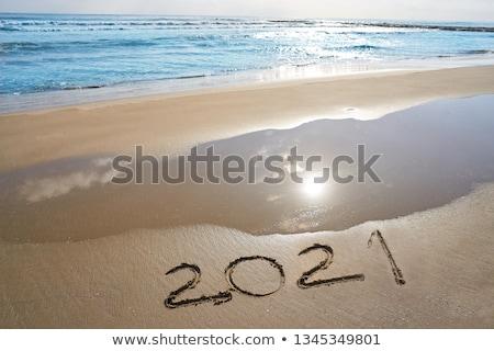 year 2021 numbers spell written on beach stock photo © lunamarina