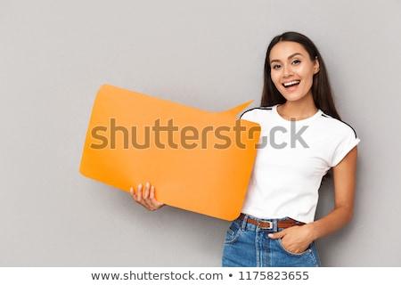 feliz · mulher · posando · isolado · cinza · parede - foto stock © deandrobot