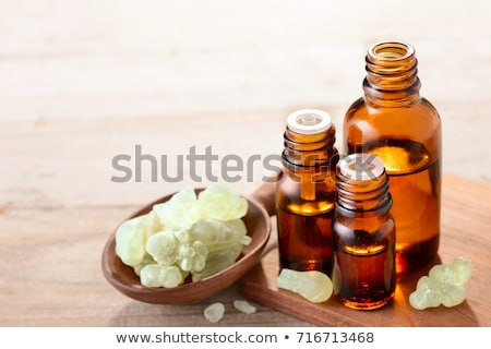 A bottle of frankincense essential oil with frankincense resin Stock photo © madeleine_steinbach