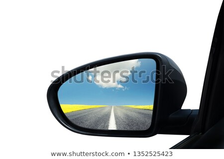 Wing mirror of a car with beautiful panorama reflected Stock photo © alphaspirit