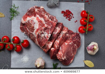 Fresh raw pork shoulder chop with spices and vegetables Stock photo © Melnyk